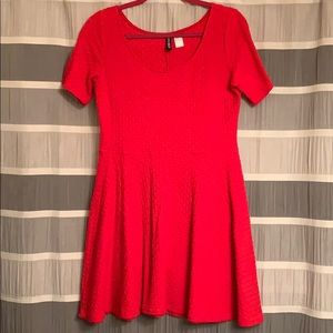 Cute red dress. Perfect holiday go to.